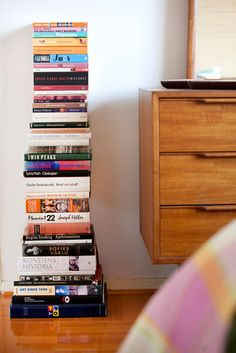 It's a blessing that shelf-less books are so very decorative. I like this arrangement.