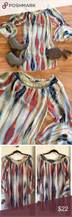 Cream printed off the shoulder bell sleeved dress Cream, red, and blue printed chiffon dress. Bell sleeve detail, cinched neck detail. Can be worn on or off the shoulder. Dress up or down. Perfect to wear all year long. Great condition! OPEN TO OFFERS! DISCOUNTS ON BUNDLES! Francesca's Collections Dresses
