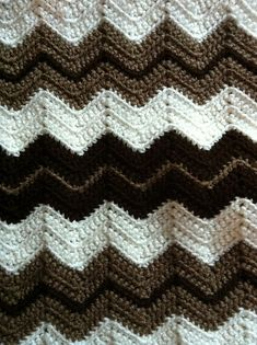Ripple Blanket ~ free pattern by Marilyn Losee.  This super-easy ripple pattern is great for a beginner.  Pic from Ravelry Project Gallery.  **UPDATE:  Made up a swatch & this works just as well using DC, which is faster.  The only difference is the ripple will be smoother & gentler, less sharp than with SC.  #crochet #afghan #throw #pillow