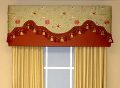 Simple cornice w/ fancy curtains over the top for pizazz