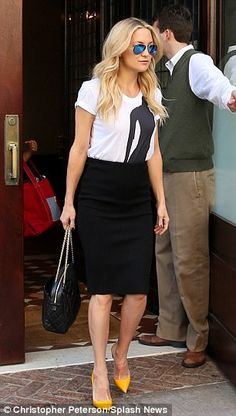#workwear #streetstyle | Kate Hudson white and black graphic tee a black high-waisted pencil skirt styled w orange pumps