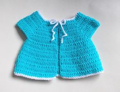 There are loads of little crochet baby jackets available but I couldn't find exactly what I was looking for.