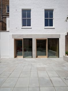 Cohen House is a minimalist home located in London, United Kingdom, designed by Morris+Company Exterior Design, Interior And Exterior, Roof Extension, Fire Escape, Brick Facade, Minimalist Architecture, London House, Entrance Doors, Minimalist Home
