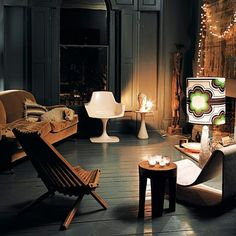 love the 60's style chair against grey walls and lamp