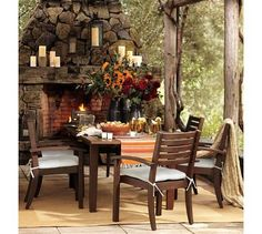 Just love the look of the outdoor fireplace and the table decorations. Nice idea for flowers for Thanksgiving table.