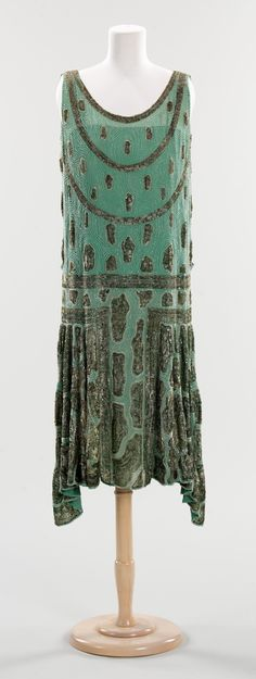 """Evening Dress: 1925, French, silk. """"During the 1920s, nightlife ruled over the day. Men and women dressed for an evening out, filled with dinner, cocktails and dancing. Dress for women changed dramatically, as hemlines rose and waistlines dropped, creating a tubular silhouette..."""""""