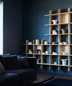 Find the right balance between decoration and storage. Sparsely filled, light display shelves against a dark background create a calm, here… Ikea Shelves, Wooden Shelves, Display Shelves, Shelving, Ikea Furniture, Unique Furniture, Home Office Shelves, Ikea Lack, Dark Walls