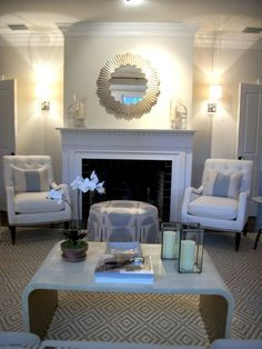 Not the colors or decor, but like having sconces on either side of FP, also like the seating arrangement. This would work in our living room.