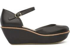For Spring Summer 2013 Camper presents Damas, a black closed sandal with a 6cm platform made of full grain leather.