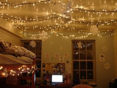 Christmas mini lights along the roof with hanging paper snowflakes