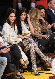 eac59284e Kendall and Kylie Jenner Share Plenty of Sisterly Moments (and Side-Eye) at  the Lakers Game
