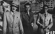 Bratislava, c. June 1944. Vrba on the right, and on the left, Arnost Rosin, who escaped from Auschwitz on 27 May 1944. The man in the middle is Josef Weiss of the Bratislava Ministry of Health, who secretly made copies of the Vrba-Wetzler report, which the escapees hid behind a picture of the Virgin Mary in their rented apartment.[41]
