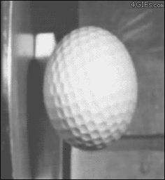 A golf ball hitting a hard surface in slow motion