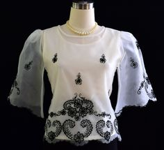 The demure appeal is perfect on this sweet organza blouse. With bell sleeves and floral give this top a feminine fit. Dress it up with a skirt or pair it with black pants for a style. Barong Tagalog For Women, Filipiniana Dress, Philippines Fashion, Trendy Fashion, Womens Fashion, Line Shopping, Black Dress Pants, Embroidered Blouse, Traditional Dresses