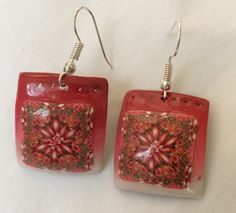 Red and white tile earrings.