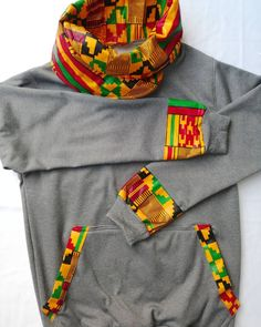 Kente lovers where are youThis kente customized snoodie is in stock and going for Ksh1700 only and its definitely unresistable  Available in grey navy blue maroon red and jungle green.Contact  0715672750 Location  Kahawa west Market stall number S49.BUY KENYAN BUILD KENYA. AllAfrican  dresses  art  accesories  tshirts  jackets  beadwork  tracksuits  dashiki  ladieswear  brands  love  rage  ankara  kitenge  lookgood  fashion  awesomeness  FeelGood  ankarastyle  MadeInKenya  culture… Most Beautiful Pictures, Cool Pictures, Dresses Art, Kitenge, Dashiki, Rage, That Look, Navy Blue, Instagram Posts