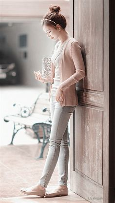 Blush pink cardigan, cream soft top, silver sequined clutch, neutral ballet flats and light wash denim straight leg jeans.