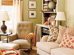 fran keenan's living room.  like the pops of tangerine.