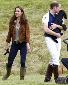 Kate Middleton and Prince William with their dog Lupo at Beaufort Polo Club in Westonbirt, Gloucestershire on June 17, 2012.