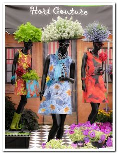 """Mannequins with """"floral hats"""" make eye catching centerpieces for a floral event"""