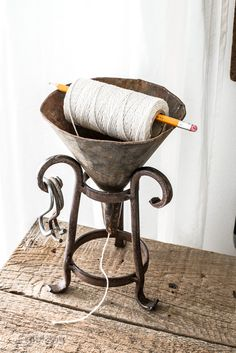 Oil funnel string dispenser / A secret to getting a true, homey home / funkyjunkinteriors.net