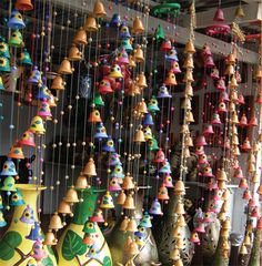 7. Wind Chimes ~ If a traveler ever makes it to San Juan De Oriente, Nicaragua they will immediately be drawn to the bright colored bells hanging along the streets. The wind chimes are all hand made by the artisans in this area. They are hand cast, strung and painted. The bright colors are vibrant like the jungle.