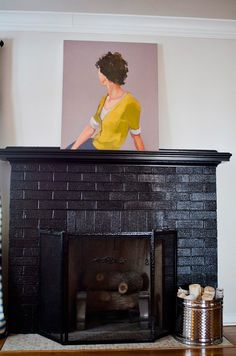 Why it's worth painting your brick fireplace. Black fireplace