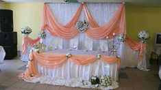 White pipe and drape backdrop with cool white fairy lights and peach satin swags. Head Table Wedding, Bridal Table, Wedding Stage, Wedding Events, Dream Wedding, Decoration Evenementielle, Stage Decorations, Balloon Decorations, Wedding Decorations