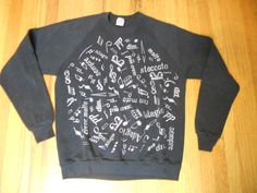 Vintage Musical Note And Opera / Classical music latin terms Black cool old sweatshirt! tagged a size x-Large Chest measures 21 good vintage condition.