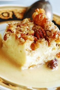 Someone said: My favorite bread pudding! With white chocolate, caramelized pecans, raisins, and whiskey cream sauce!