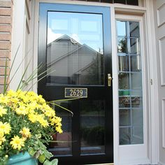 Replacement Entry Doors – Black entry door with decorative sidelights and black … – farmhouse front door with screen Black Screen Door, Black Entry Doors, Front Door With Screen, Entry Door With Sidelights, Storm Doors With Screens, Aluminum Storm Doors, Sidelight Windows, French Windows, Farmhouse Front