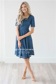 Who doesn't love an absolutely beautiful lace dress! This stunning Dusty Navy lace dress features half sleeves, a round neckline and princess seams. The romantic dress will not disappoint and is forever timeless!