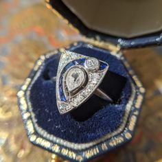 Vintage Art Deco Engagement Ring with a Pear Cut Diamond and Sapphire Accents set in Platinum 1920s Engagement Ring, Platinum Engagement Rings, 1920s Art Deco, Art Deco Diamond, Antique Rings, Antique Jewelry, Dream Ring, Blue Rings, Art Deco Fashion
