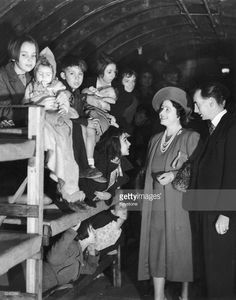 Queen Elizabeth beaming at children in their bunks during a visit to an air raid shelter in London. Get premium, high resolution news photos at Getty Images British Home, London History, The Blitz, Air Raid, Queen Of England, Queen Elizabeth, Beams, Britain, Children