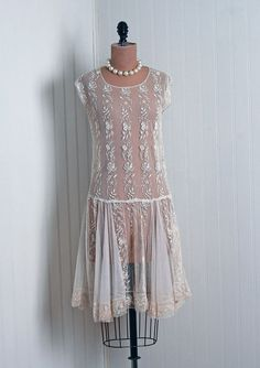 Sheer 20's dress.  Must learn how they wore these.