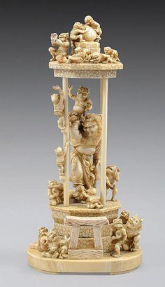 AN UNBELIEVABLE WORK OF ART. A JAPANESE IVORY GROUP OKIMONO