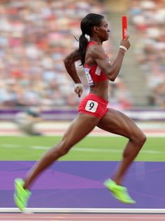 DeeDee Trotter of the United States competes during the Women's 4 x 400m Relay Round 1 heats on Day 14 of the London 2012 Olympic Games at Olympic Stadium on August 10, 2012 in London, England.