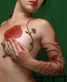 Beautiful breast tattoo that creatively wraps around the arm. Inspiration for a mastectomy tattoo [p-ink.org].