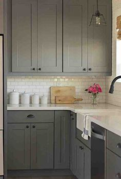 Gray cabinets, subway tile backsplash