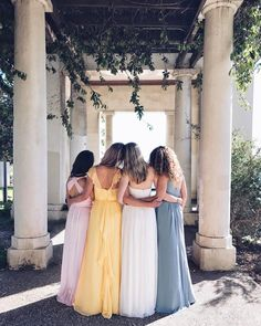 An unexpected mix of bridesmaid colors and bridesmaid dress silhouettes for your perfectly mismatched bridal party. Yellow, pink, and blue mismatched bridesmaid dresses. Get these looks at David's Bridal | Styled by Erica Chan Coffman of honestlywtf