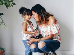 A gorgeously designed mommy and me combination to welcome the warmer spring and summer days, made with a colorful Southwestern print filled with tribal markings and diamond shapes. The off the shoulder ruffle top for mom is held by an elastic while the baby girl shirt is held up by two small matching straps.