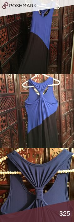 """Calvin Klein blue and black dress Size 4    Calvin Klein sleeveless dress has a cute gathered t-back and bold blue and black diagonal color.  Full pictures represent true colors.  95%rayon/5% spandex/machine wash.   40"""" from shoulder to hem. Excellent condition.  ❌sorry no trades Calvin Klein Dresses Midi"""