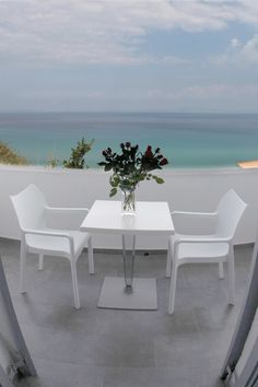 Luxurious minimalist, White Suites Resort in Afitos Halkidiki breathes purity and sophistication. Dining Table, Minimalist, Luxury, Furniture, Home Decor, Homemade Home Decor, Dinning Table Set, Home Furnishings, Interior Design