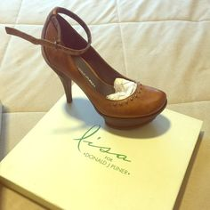 Lisa for Donald J. Pliner. $225, selling for $50. Never worn Lisa for Donald J. Pliner platform leather pumps with small studs. Lisa's signature green sole. Comes with original box and original dustbag. Heels are 4.5 inches tall. Lisa for Donald J. Pliner Shoes Heels