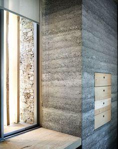 armando ruinelli: redevelopment of a barn, soglio/smooth interior concrete wall meets rustic exterior stone wall: