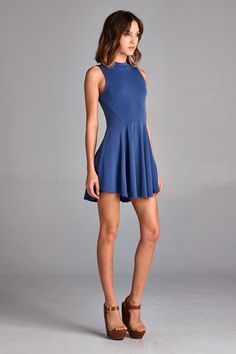 Fitted, stretchy skater dress with high neckline in medium blue color.