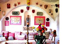 """""""This room devoted to Mexican folk art features dance masks, indigenous pottery, naïve drawings, and comfy pillows made of huipiles (indigenous woven dresses from Oaxaca, Chiapas and Guatemala)."""""""