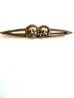 Gustav Gaudernack design for own workshop. Silver brooch with gargoyle motif from Trondheim cathedral. ca 1905-1914