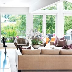 From the cool sand-coloured sofas and silver dining table, to the white oak floor, every finish keeps the space light. #homedecor #design #livingrooms