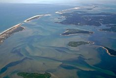 """""""Pleasant Bay Aerial Photo Looking Toward Chatham"""" by Christopher Seufert, Chatham, Cape Cod // The outer beach and Monomoy are included in this image from April, 2008, part of my hard cover photography book """"Chatham by Air: Aerial Photos of Chatham, Cape Cod.""""  http://www.blurb.com/bookstore/detail/283179 // Imagekind.com -- Buy stunning, museum-quality fine art prints, framed prints, and canvas prints directly from independent working artists and photographers."""